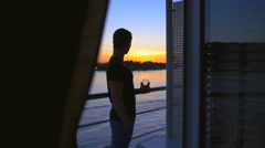 3 in 1 video! Man stand on the ship balcony and drink water by sunset and boat  Stock Footage