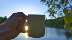 3 in 1 video! Man take cup and drink coffee or tea by sun, tree and lake Stock Footage