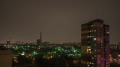 The thunderstorm above the industrial pipe in the city at night Stock Footage