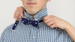 Close up of Female Tying Bow Tie Around Male Neck Stock Footage
