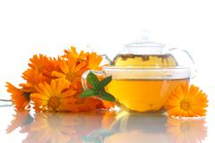 Herbal tea with marigold flowers - stock photo