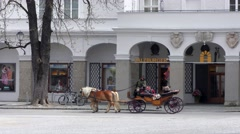 Traditional horse-drawn carriage on the Residenz Square in Salzburg, Austria Stock Footage