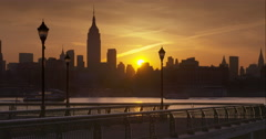 Two passengers ferries traveling on the Hudson River with the sun rising Stock Footage