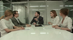 Closeup of group of business people applauding at a meeting Stock Footage