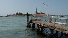 Pier at Bacino S. Marco canal in Venice Italy Stock Footage