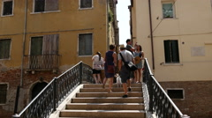 Tourists at the bridge at Campiello Drio La Pieta in Venice Italy Stock Footage