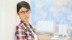 Young woman in office adjusting eyeglasses on Stock Footage