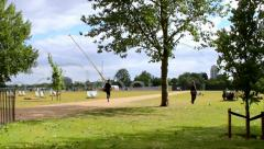 Tourists and locals in the famous Hyde Park at a cool cloudy summer day Stock Footage