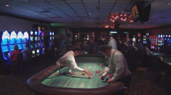 Wide Shot Gaming Area With Craps Table Inside Casino Stock Footage