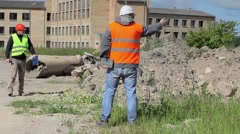 Construction employees near building Stock Footage