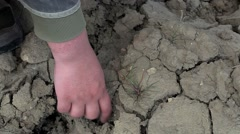 Hand near cracked dry ground Stock Footage