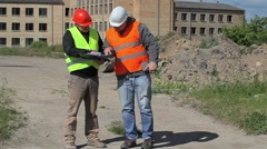 Construction employees with documents near building Stock Footage