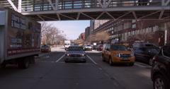Driving under a pedestrian bridge over the West Side Highway in Manhattan Stock Footage