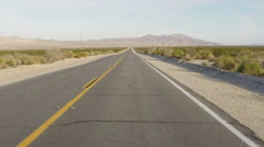 Car Viewpoint- Mojave Desert Highway Stretching To Horizon Stock Footage