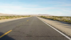 Car Viewpoint- Driving Mojave Desert Highway- Fast Motion Stock Footage