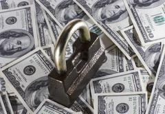 The lock which is located on money Stock Photos