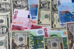 Heap of dollars of the USA and  EURO - stock photo