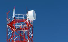 radio  tower on a background of the blue sky - stock photo