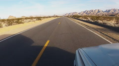 Vehicle Viewpoint Traveling Deserted Desert Road Time Lapse - stock footage