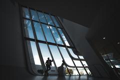 Wedding couple in a futuristic building - stock photo