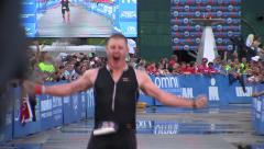 Very happy IronMan race finisher Stock Footage