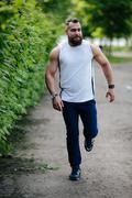 Bearded man runs Stock Photos