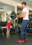 man and son in the gym - stock photo