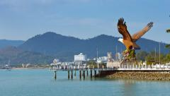 Eagle Statue Stands, Overlooking Busy Harbor Stock Footage
