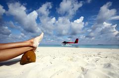 Airwoman has a rest on a sandy beach, Maldives Stock Photos