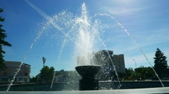 Fountain in the sun shine under a blue sky, slow motion Stock Footage