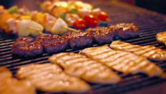 Assorted Meats on a Turkish Street Vendor's Barbecue Grill Stock Footage