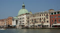 Water taxi passing by the San Simeone Piccolo in Venice Italy Stock Footage