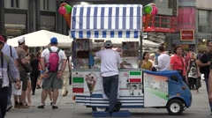 ULTRA HD 4K Famous italian gelato ice cream machine street car market Vienna day Stock Footage