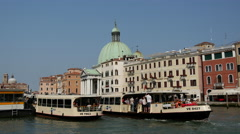 Ferries at the canal in front of the San Simeone Piccolo in Venice Italy Stock Footage