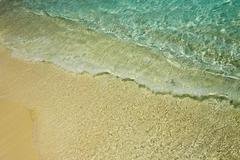 Nice blue water ripples near a shore in the Indian Ocean - stock photo