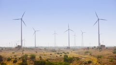 Huge Wind Farm on an Arid Plain Stock Footage