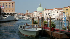 Water taxi at the pier at the canal grande in Venice Italy Stock Footage