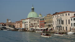 Water taxis at the canal grande close to the San Simeone Piccolo in Venice Italy Stock Footage
