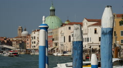 Blue poles at the canal grande in Venice Italy Stock Footage