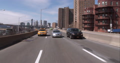 Driving on the FDR Drive with downtown Manhattan in the background - stock footage
