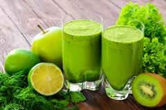 Blended green smoothie with ingredients selective focus - stock photo