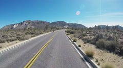 Viewpoint Driving In Joshua Tree National Park Past Bicycle Riders - stock footage