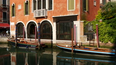 Boats and house reflection in a Canal in Venice Italy Stock Footage