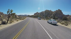 Viewpoint Driving In Joshua Tree National Park Past Rock Mounds Stock Footage