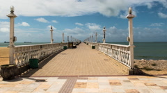 View of cityscape and pier on Praia do Forte beach Stock Footage