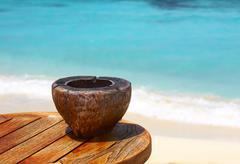 Ashtray on a beach table - stock photo