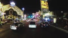 Rolling Las Vegas Boulevard Past Brightly Lit Casinos- Night Stock Footage