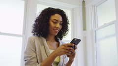Beautiful black woman using phone in bathroom Stock Footage