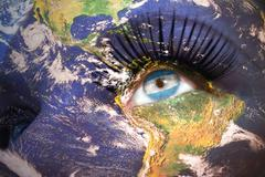Stock Photo of woman's  face with planet Earth texture and argentinean flag inside the eye.