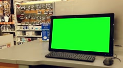 Green billboard for your ad at computer screen inside home depot store. - stock footage